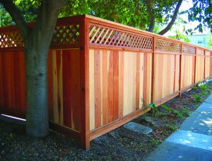 redwood fence with lattice and different grains