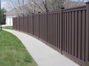 Trex board on board composite fence dark color.