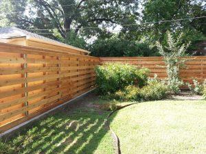 horizontal wood fence with metal posts